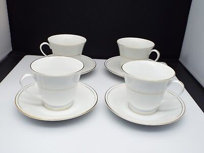 Boxed Set Of 4 Vintage Footed Tea Cups and Saucers White Gold Trim