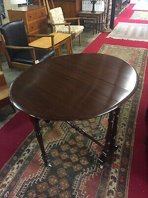 Victorian Gate Leg / Drop Leaf Mahogany Sutherland Table on Original Castors