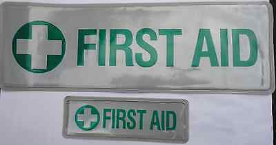 FIRST AID badge (a pair), reflective, sew-on, large and small
