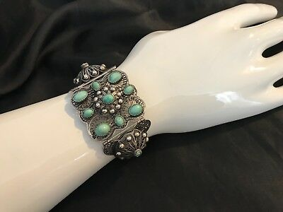 ANTIQUE HAND MADE SILVER BRACELET FROM 1900s DECORATED WITH TURQUOISE.