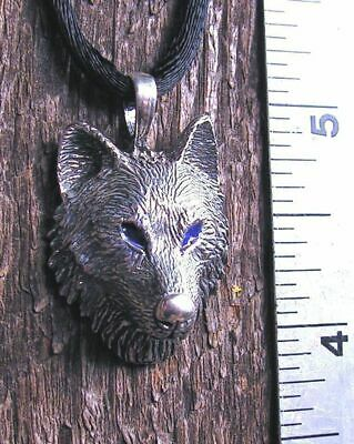 Wolf Pendant With Blue Eyes In Sterling Silver