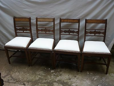 A set of four late victorian dining chairs. upholstered in calico.