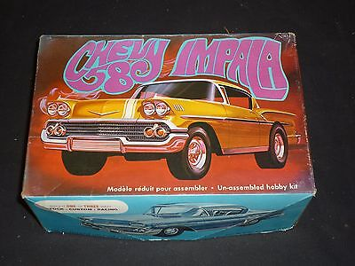A Vintage 1978 AMT Un Made plastic kit of a 1958 Chevrolet Impala, boxed
