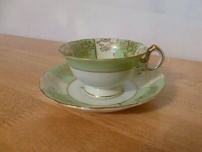 """Vintage """"Old Gold"""" Japan Green, White, Gold Hand Painted Footed Tea Cup & Saucer"""