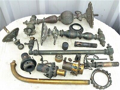 Sundry brass gas lamp fittings, taps, arms and small parts for repairs.