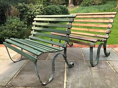 PAIR OF small vintage garden benches with decorative wrought iron bench ends