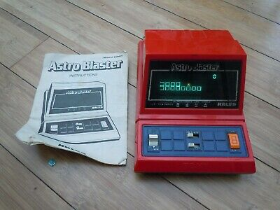 Tomy Astro Blaster retro 80s handheld video game, working with instructions