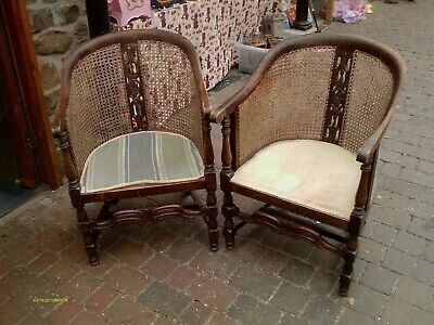 pair of antique bergere tub chairs