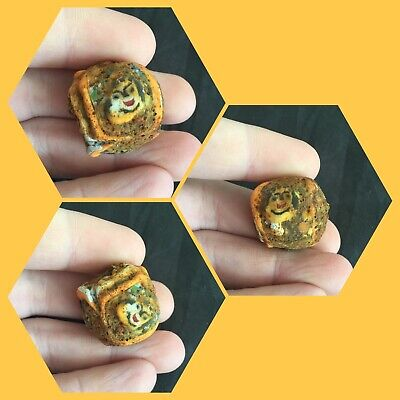 Rare ancient Phoenician glass bead with faces, 300 bc