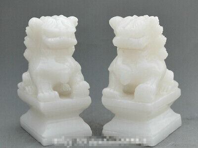 A pair 100% China Fengshui Natural White Jade Hand-Carved Statues Foo Dog Lion