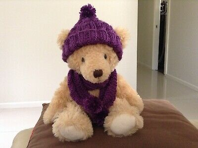 hand knitted teddy bear clothes. Cable patterned bobble hat and scarf