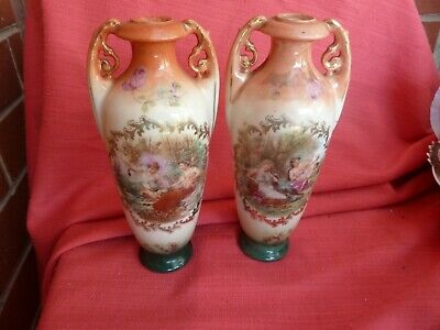 Pair of small Antique vases.18 cm tall.