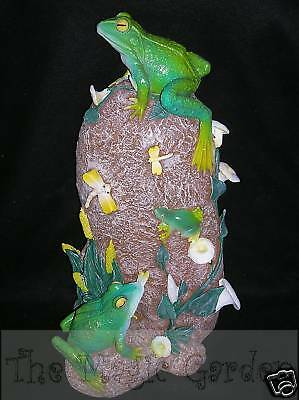 Frogs insects on a  rock garden ornament cement plaster craft moulds molds