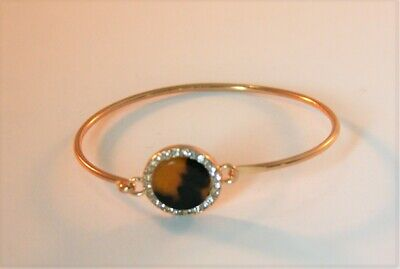 Gold tone round crystal & faux tortoise shell hook bangle bracelet