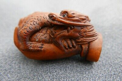 Hand Carved  & signed netsuke boxwood Dragon in the Hand of Buddha