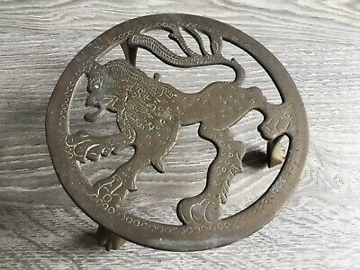 Vintage Brass Trivet With Chinese Lion Design 3 Claw Feet.