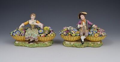 Pair of William IV Minton Figures Sitting Between Baskets Of Flowers Models 58