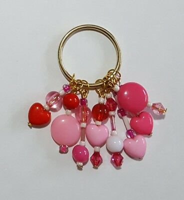 Handmade red and pink beaded keyring with all proceeds going to Sue Ryder charit
