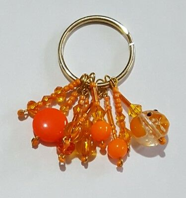 Handmade orange dog beaded keyring with all proceeds going to Sue Ryder charity