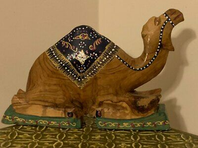 Hand carved and painted wooden camel