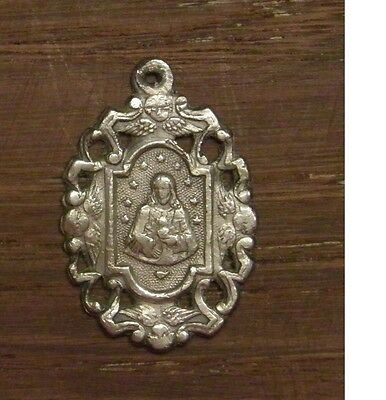 Antique religious silvered medal pendant the sacred heart of Jesus IHS angel
