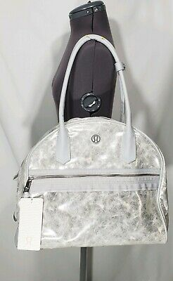 a0ee2dcaa8 NWT Lululemon Sweat Once A Day Yoga Gym Bowler Bag Silver Metallic Mat Strap