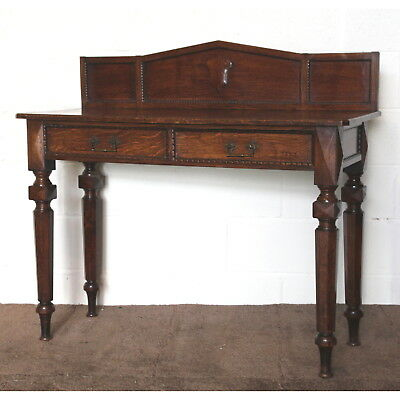 A Quality Victorian Oak Two Drawer Side Table raised on Octagonal Supports