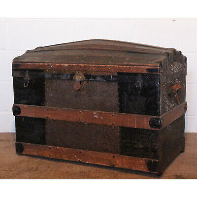 A C19th American Dome Topped Wooden Bound Travel Trunk Floral Decoration