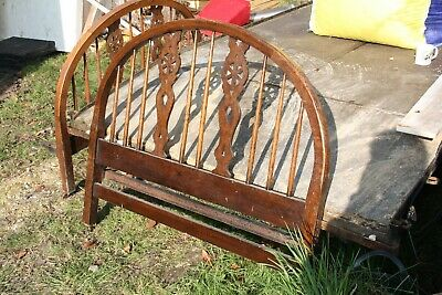 An Arts and Crafts Oak 4 ft Bed with original iron side rails.