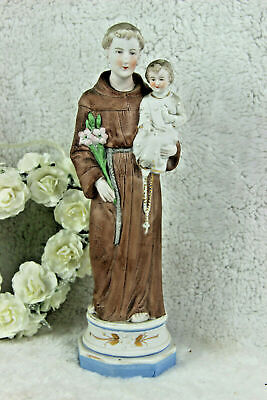 Antique religious porcelain bisque figurine of saint anthony with child