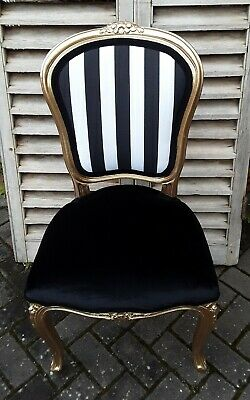 Gold french louis chair reupholstered in jet black velvet
