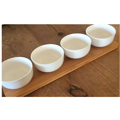 Four Dip Bowls On A Wooden Base - Unused.