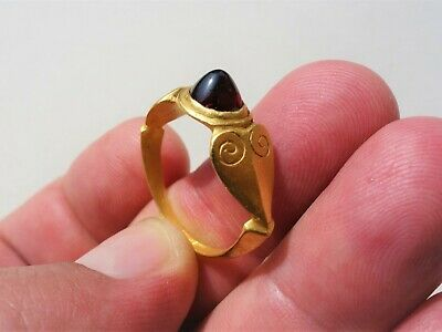 early Medieval gold ring the circle shaped bezel is set with convex oval garnet