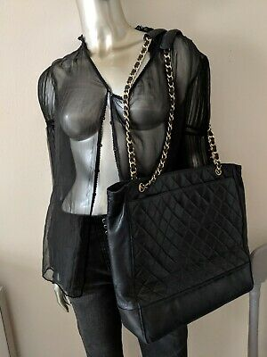 Authentic vintage Chanel tote bag black lambskin leather gold chain quilted