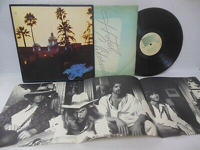 THE EAGLES exc vinyl lp HOTEL CALIFORNIA with poster