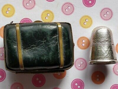 VINTAGE SILVER THIMBLE (UNMARKED) WITH BLUE LEATHER CASE Weight of thimble 3g