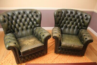 2 Green leather chesterfield chairs. Much loved. Worn condition adds character