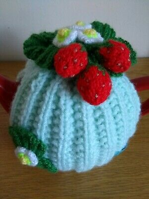Hand-knitted mint green rib tea cosy with strawberries. Medium size
