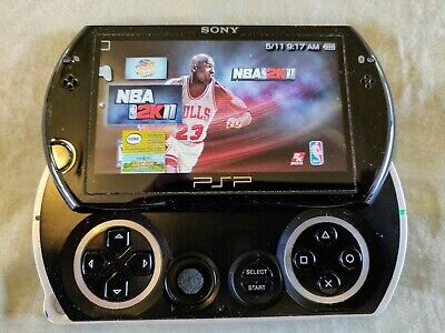Sony PSP Go 16GB Piano Black Handheld System Bundle - 2 Chargers, 3 Games