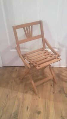 Vintage folding child's wooden slatted chairs