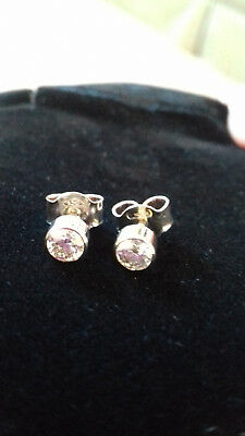 Pair of diamond single stone white gold stud earrings. French fittings