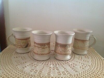 4x SIGNED WITH A SEAL STAMP POTTERY MUGS. (UNKNOWN MAKER).