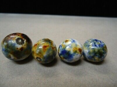 VINTAGE MARBLES A selection of clays, crockery and stoneware