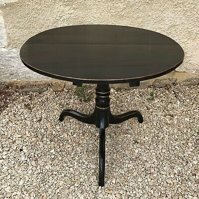 Antique mahogany tilt top tripod table refreshed in ebony black livery.
