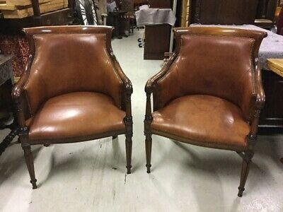 A Pair of Regency Style Mahogany Tub Shaped Library Armchairs
