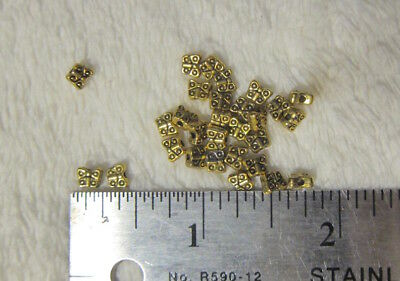 NOS Destash BEADS FINDINGS ETC: 26 Tiny ornate BUTTERFLY Beads -YELLOW metal