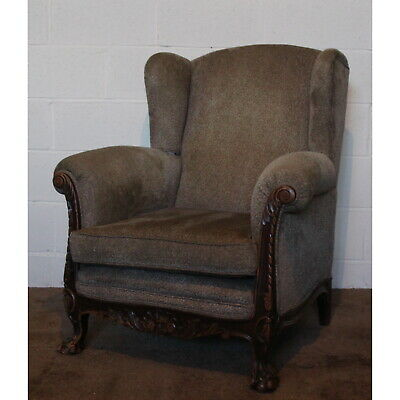 A Large Carved Mahogany & Upholstered Wing Arm Chair with Ball & Claw Feet