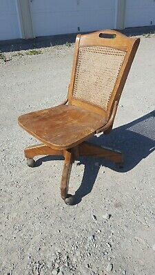 Antique Vintage Oak Woven Cane Rolling Adjustable Swivel Banker Lawyer Chair