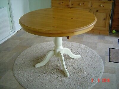Table, round extending Cotswold pine topped table.