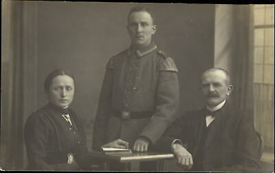 WWI era German soldier with parents ~ RPPC real photo postcard TRIMMED top edge
